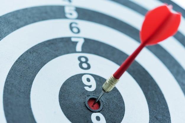 dart-target-arrow-hitting-bullseye-with-sun-light_1357-287