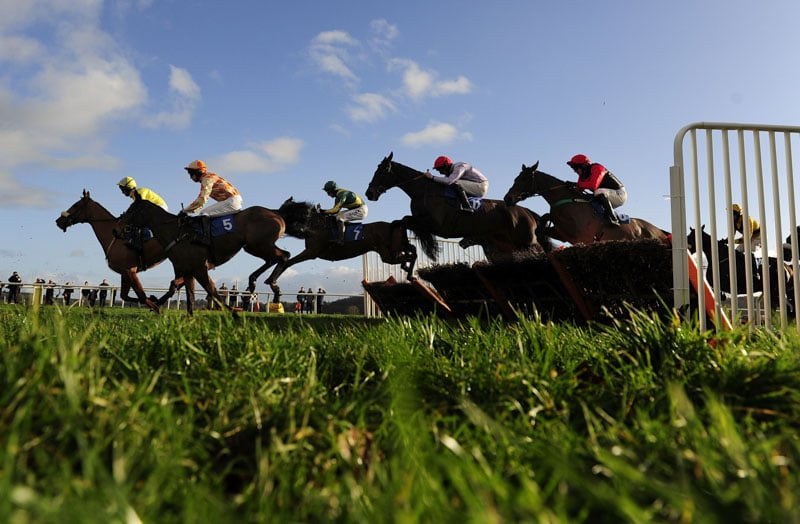 Runners clear a flight in the home straight - RACE 3 - 13.45 - totequadpot Four Places In Four Races Novices« Hurdle - PHOTO mandatory by-line: Dan Mullan/Pinnacle - Photo Agency UK Tel: +44(0)1363 881025 - Mobile:0797 1270 681 - VAT Reg No: 768 6958 48 - 30/12/2013 - EQUESTRIAN - HORSE RACING - Taunton Racecourse, Taunton, Somerset.